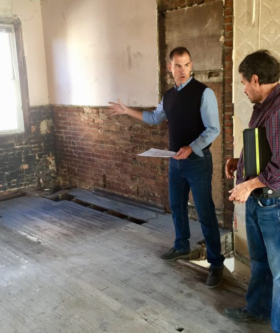 Joel consults with a contractor to prep a home for sale.